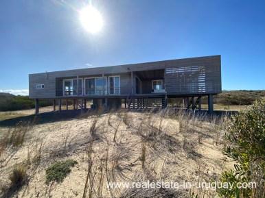 House backside of Frontline Beach Home in San Antonio close to La Pedrera in Rocha with Sea Views