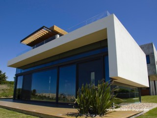 Outside of Modern High-Tech Home in Laguna Blanca by Manantiales