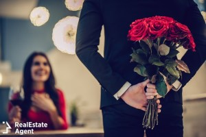 man in suits with red roses surprise