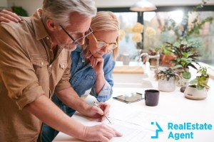 mature couple reviewing and signing domestic finances