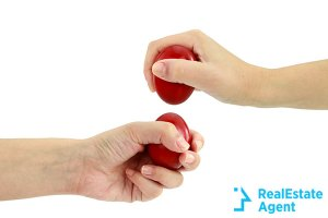Close-up of two hands ready to begin an egg-fight