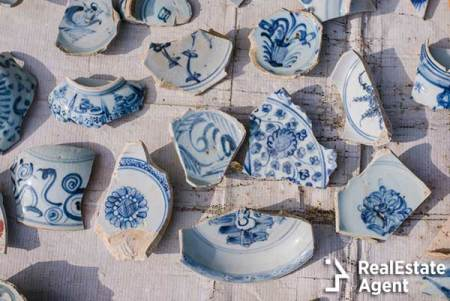 Broken pieces of porcelain pots lying on the streets of Greece after Easter