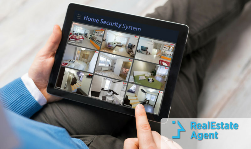 Close Up Of A Hand Scrolling An IPad Filled With Smart House Security  Systems