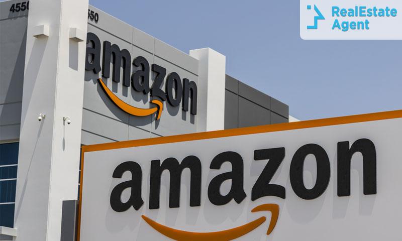 An Amazon Location behind an Amazon sign