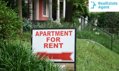 A sign reads apartment for rent outside in the curb