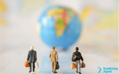 businessmen figurines walking towards USA