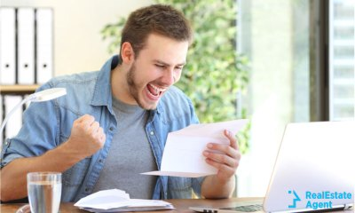 young entrepreneur being super excited and happy regarding some letter results