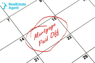 mortgage paid off written with red on a calendar