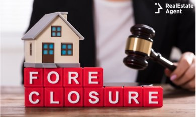 Man with gavel behind foreclosure sign