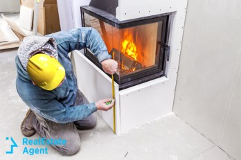 Contractor installing fireplace