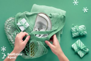 Woman putting articles of clothing in string bag
