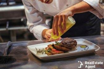 chef in restaurant arrangin
