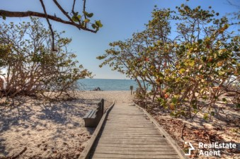 boardwalk across the white sand beach naples florida