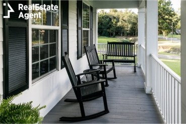 front porch with black chairs
