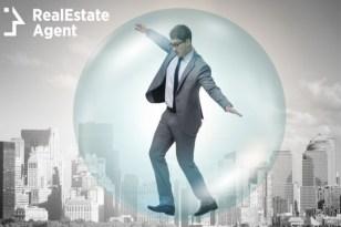 businessman flying inside a bubble