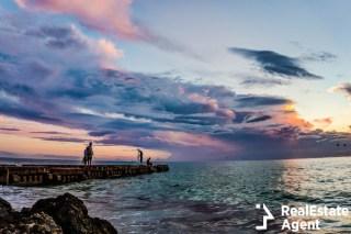 sunset over the broken pier