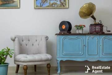 vintage interior of white armchair, vintage wooden light blue