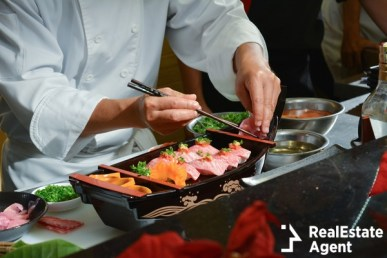 chef making kobe sushi on boat
