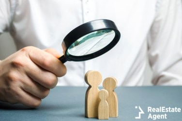 man look through magnifying glass