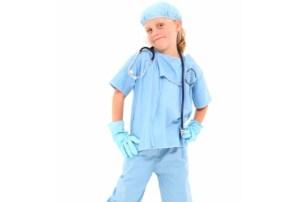 adorable girl in surgical scrubs
