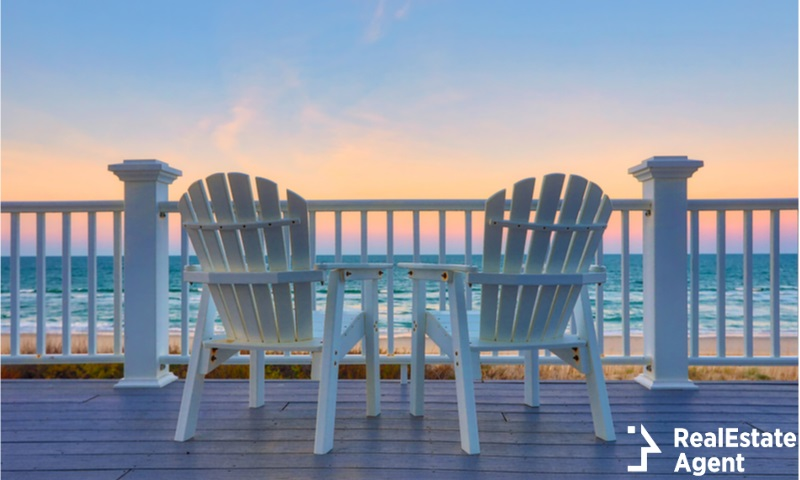 empty chairs on a balcony deck on the beach