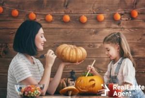 happy halloween mother and daughter carving pumpkin