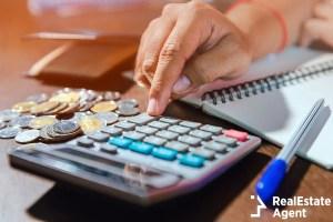 money concept man using a calculator
