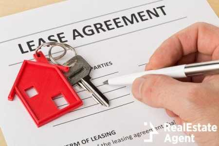 man holding lease agreement