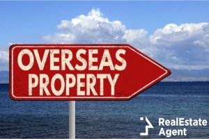 overseas property metallic sign