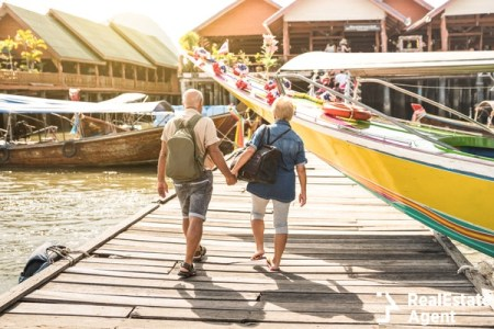 Senior couple walking hand in hand