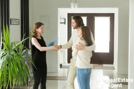 Landlord welcoming happy new tenants
