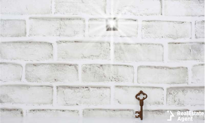 Keyhole brick wall bright light shinning