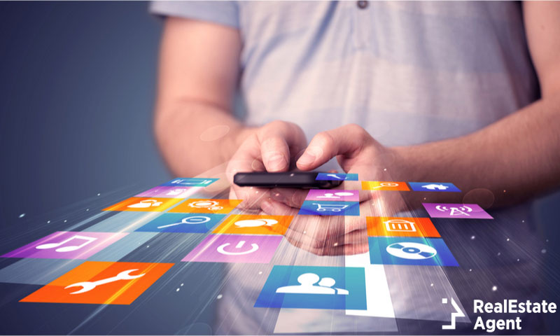 man holding smartphone colorful application