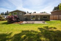 house-back-2 Laurie Way Announces | Des Moines Multi-Level Home with Large Yard!
