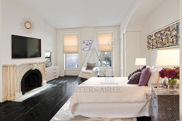 One of the four bedrooms in the duplex property - Courtesy of Peter*Ashe Real Estate