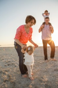 family-walking-along-beach-1117011-gallery