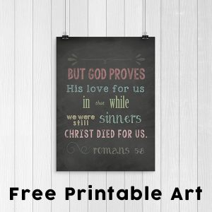 Free Printable: A chalkboard style Scripture art print download featuring the Bible verse from Romans 5:8 reminding us of God's great love for us.   Real Life at Home