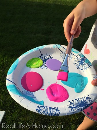 Loading up the paint for our outdoor splatter painting activity