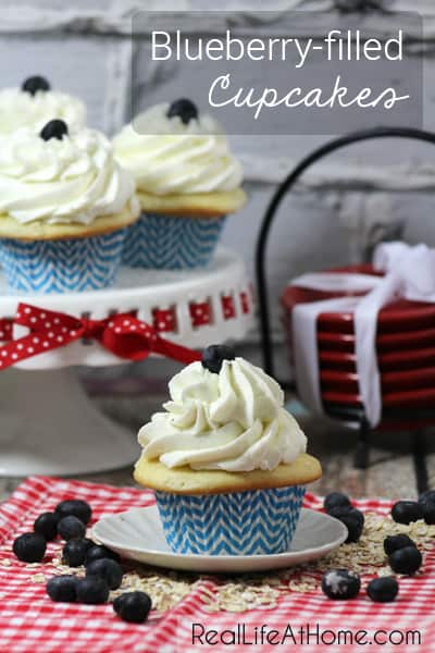 Perfect for summertime, or a dose of summer in the middle of winter, these blueberry-filled cupcakes can be modified to other flavors as well