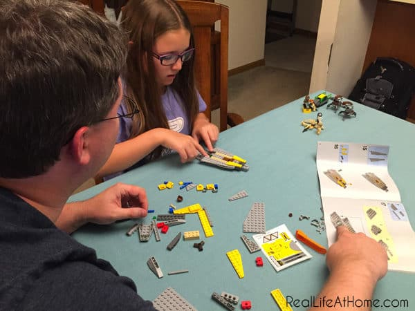 Dad and Daughter building LEGO Star Wars construction set together