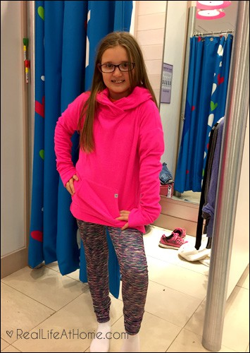So excited for her bright sweatshirt and leggings at Justice