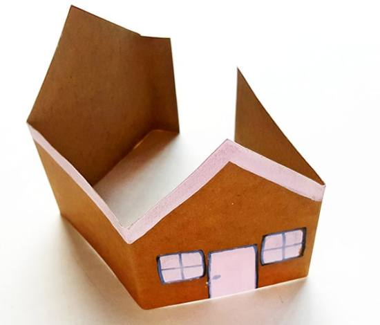 Gingerbread Craft Step 4 (folding the Gingerbread House Paper Craft) from Real Life at Home