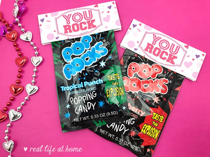 """Need a quick treat bag for Valentine's Day, a class party, a team motivator, or just a little pick me up? Print out this free """"You Rock"""" Pop Rocks Treat Bag Topper and attach it to a bag of Pop Rocks, rock candy, chocolate rocks, or a Ring Pop for a quick and easy surprise."""