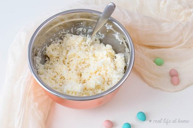 Mixing coconut and condensed milk for coconut nest cookies