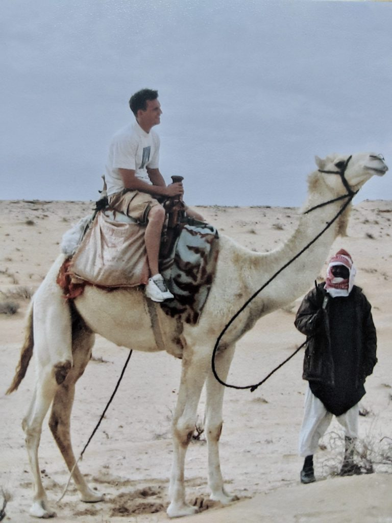 Man on camel in the Sahara
