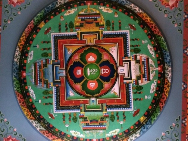 A mandala painted on the ceiling of the gompa at Tushita Meditation Centre