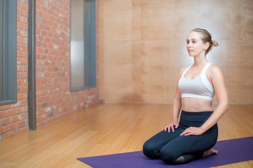 how to stretch knees after cycling - camel pose