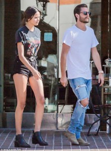 324257C400000578-3495775-A_pal_Scott_Disick_was_seen_with_a_young_woman_as_they_left_Tosc-m-80_1458159263903