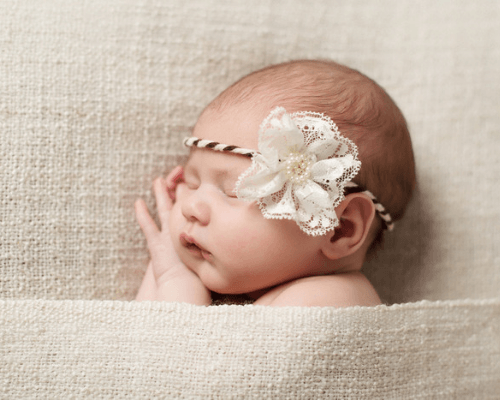 Elegant girl with flower headband sleeping