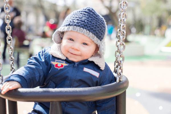 cute baby boy on a swing